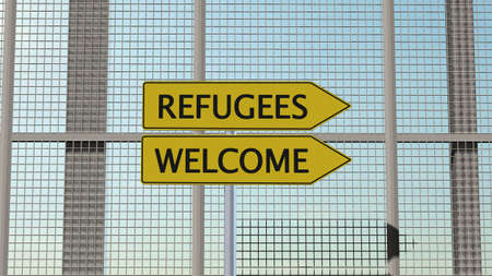humane: Refugees Welcome signpost on metal fence border fence Stock Photo