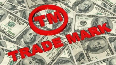 TM - Trademark sign and lettering on 100 bills Stock fotó