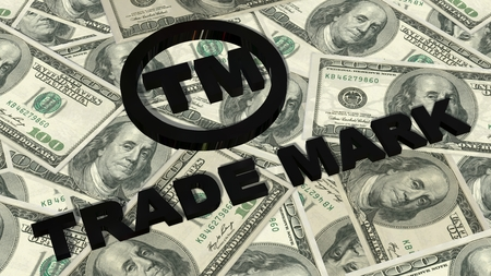 tm: TM - Trademark sign and lettering on 100 bills Stock Photo