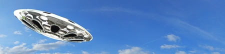 invasion: UFO flying saucer in the sky