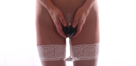 Beautiful young nude women in elegant lingerie with wineglass
