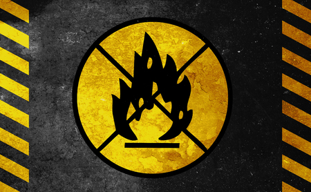 flammable materials: old yellow danger sign - fire