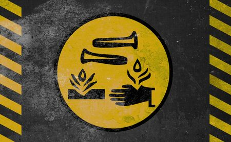 caustic: old yellow danger sign - Acid Stock Photo