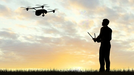 urbane: one operating of flying drone Quadrocopter UAV at sunset