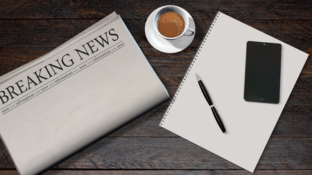 newspaper headline: office table with blank newspaper and the headline breaking news and smartphone on a white spiralbound paper drawing pad Stock Photo