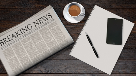 newspaper headline: office table with newspaper and the headline breaking news and smartphone on a white spiralbound paper drawing pad Stock Photo