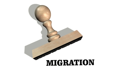 migration - Wooden stamp with the word migration isolate on white background Stock Photo