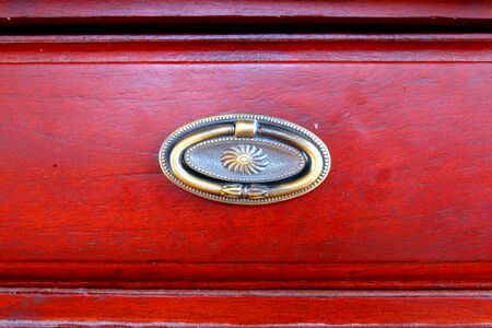 at close quarters: drawer handle antique style Stock Photo