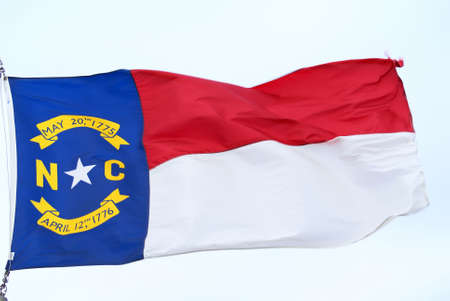 Flag of North Carolina waving in the wind photo
