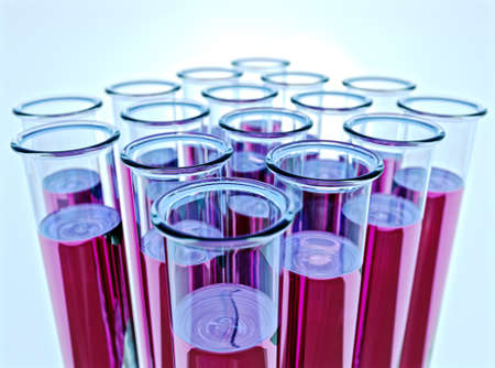 Hi-res render of sixteen test tubes containing pink fluid with  shallow depth of field and light blue background. photo