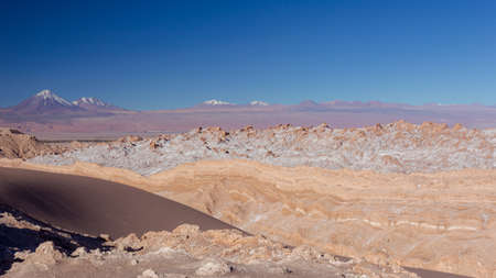 Beautiful Landscape of Salt deposits crossed by a road. Mountain formations were weathered by winds and rains.