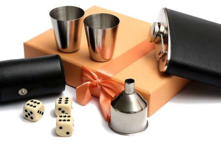 three cubes and small leather bottle with two metal tow at orange giftbox on white background