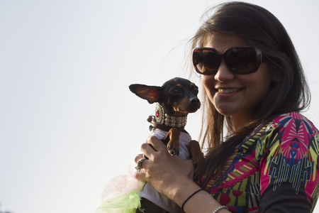 cane chihuahua: A Girl carrying Chihuahua Dog at PetFed 2015 in New Delhi, India. Editoriali