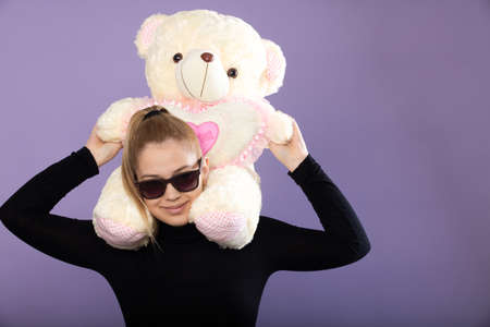 teenager is having fun with the toy bear