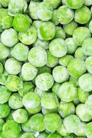 冷凍エンドウ豆ピーシズ テクスチャ背景。グリーン ピースの背景パターン。 写真素材