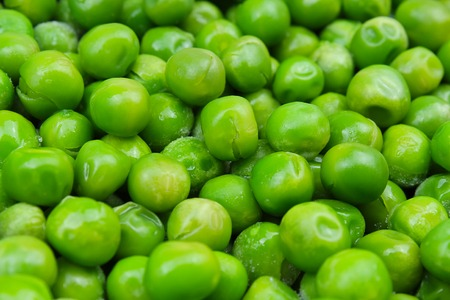 Frozen pea peases texture background. Green pease background pattern.