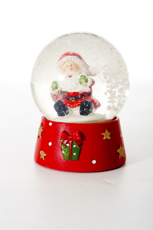 Nicholaus christmas souvenir glass ball. Dolphin Christmas Illustration. Snowing snow glass ball. Stock Photo