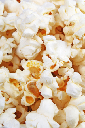 Popcorn texture. Popcorn snacks as background. Stack pile popcorn pattern.