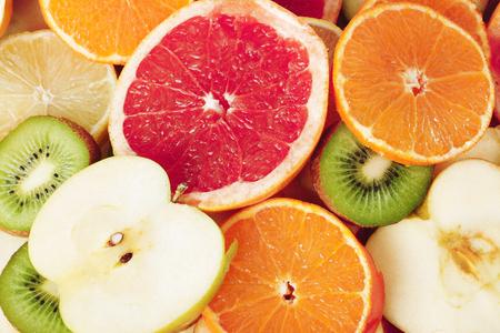 Fruit textures. Kiwi orange grapefruit lemon apple pear pomegranate mandarin fruits as background cover wallpaper. Colorful fresh fruits in rainbow colors. Beautiful delicious fruits wallpaper.