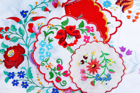 Embroidery. Patchwork handwork embroidery closeup texture pattern studio photo background. Stock Photo