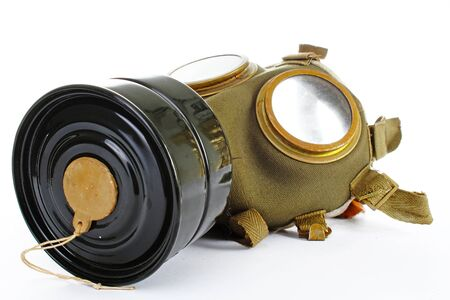 article icon: Gas mask from real war. Used vintage green and black gas mask can illustrate danger, war, catastrophe, or other concept. Gas mask on isolated white studio background. Easy to use for your work. Stock Photo