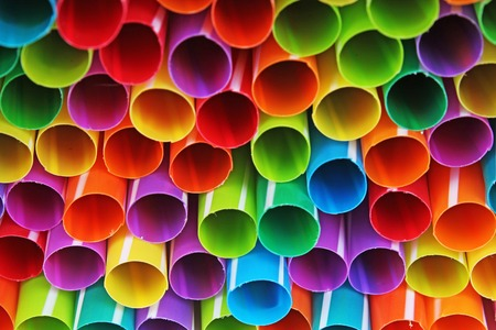 Fancy straw art background. Abstract wallpaper of colored fancy straws. Rainbow colored colorful pattern texture. Art artsy colorful rainbow cover.