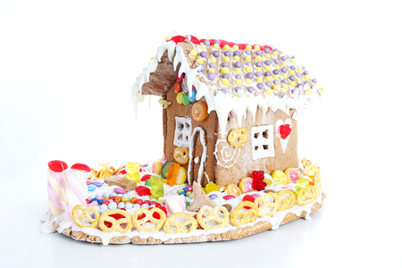 article icon: Gingerbread candy sugar house. Fairy tail candyhouse covered with snow and colorful candies Homemade gingerbread house with colorful candy decoration. Christmas ornaments. Cute christmas house.
