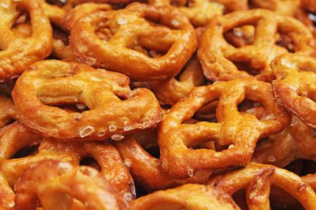 Pretzel shaped bread sticks cracker texture pattern. Salted pretzels.