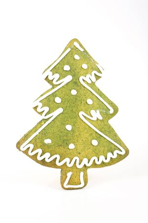 article icon: Christmas tree shaped gingerbread with dye green paint and sugar decoration. Stock Photo