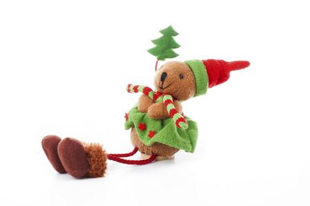 Christmas bear decoration. Cute plush toy decor for christmas. Mini Teddy bear wearing christmas costume. Winter holiday isolated white photo. Christmas concept. Stock Photo