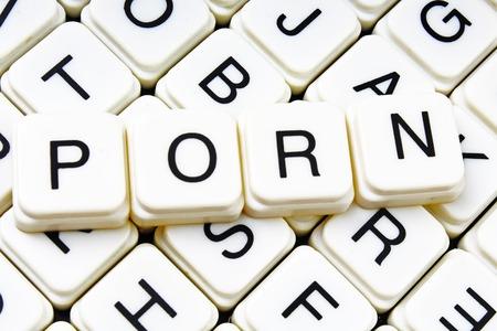Porn text word crossword. Alphabet letter blocks game texture background. White alphabetical cubes blocks letters on crossword letters educational toy background. 스톡 콘텐츠