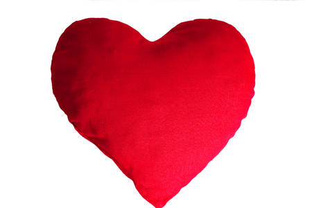 Valentines day illustration. Sign symbol of love. Fabric plush heart cushion to illustrate valentines day or mothers day or any loving concept. Colored beautiful heart on isolated white background. Stock Photo