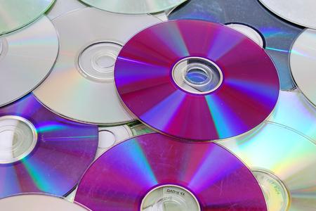 Cd,dvd reflective shiny cd dvds background texture pattern. Stock Photo