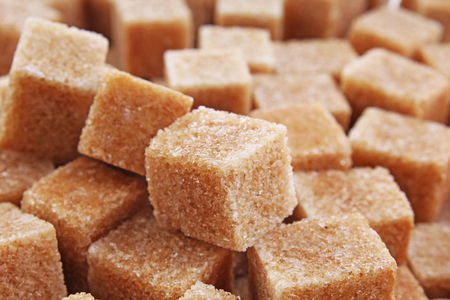 Granulated brown sugar. Lump sugar. Brown sugar cubes. Cane sugar.