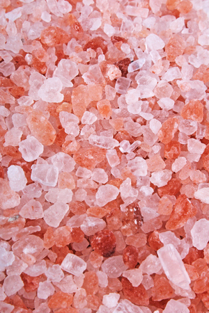 Himalayan pink rose colored natural salt. Himalayan salt crystals texture pattern as background. Healthy salt from Himalayas. Stock Photo