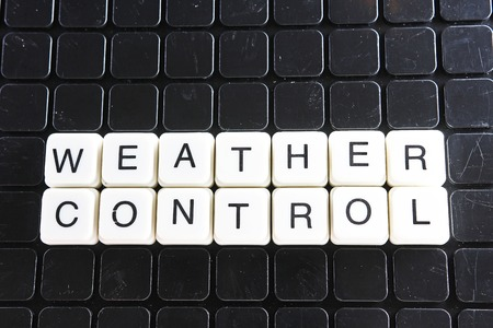 Weather control text word crossword. Alphabet letter blocks game texture background. White alphabetical letters on black background. White educational toy block with words.