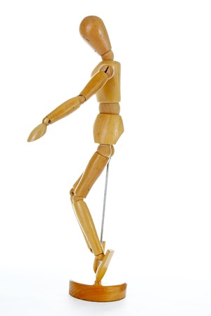 Wooden mannequin drawing model human shape. Doll human body figurine statue pose posing to illustrate human body positures for draw class or every concept. Stock Photo