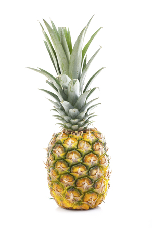 Pineapple in white studio background. Sweet delicious mellow tropical fruit. Full whole yellow pineapple. Stock Photo