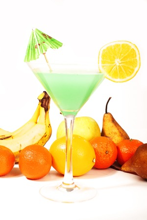 Tropical fruit cocktail concept. Cocktail with umbrella colorful illustration on isolated white studio background. Sexy delicious fashion drinks. Alcohol cocktails. Blue green cocktail with pear banana orange blue curacao.