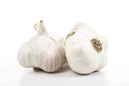 Garlic on isolated white studio background. Closeup photo. Clipping path. Easy to use. White background. Cutout cut out.
