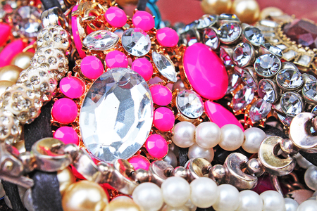 Fashion jewelrys. Fashion jewels as background. Jewelery texture. A lot of Jewells in texture. Jewellery background. Beautiful jewels pattern.Necklace pearls.