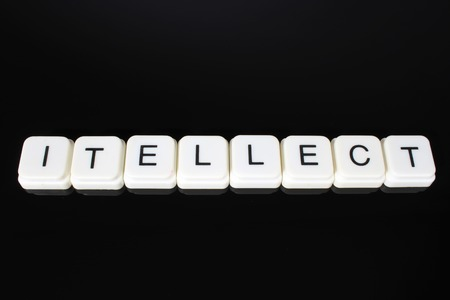 Intellect text word title caption label cover backdrop background. Alphabet letter toy blocks on black reflective background. White alphabetical letters. White educational toy block with words on mirror board table. Stock fotó