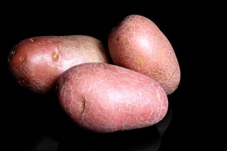 Potato potatos on black studio background. Food photos.