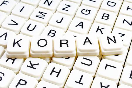 Koran text word crossword title caption label cover background. Alphabet letter toy blocks. White alphabetical letters. Koran. Banco de Imagens