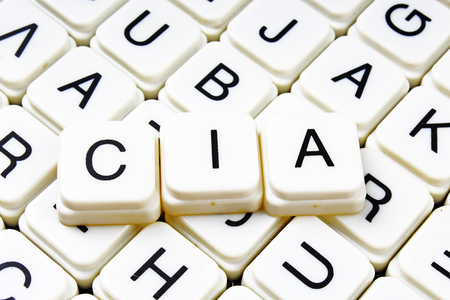 Cia text word crossword title caption label cover background. Alphabet letter toy blocks. White alphabetical letters. Cia. Banco de Imagens - 93939161