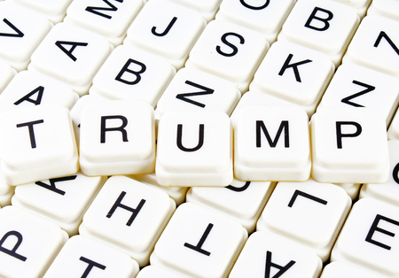 Trump text word crossword title caption label cover background. Alphabet letter toy blocks. White alphabetical letters. Trump. Stock fotó