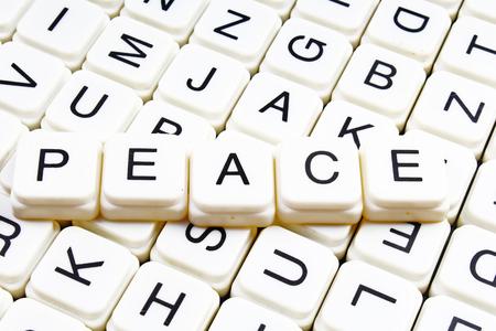 Peace text word crossword title caption label cover background. Alphabet letter toy blocks. White alphabetical letters. Stock fotó