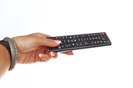 Woman hand holding remote control on isolated white cutout background. Studio photo with studio lighting easy to use. Reklamní fotografie