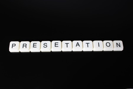 Presentation text word title caption label cover backdrop background. Alphabet letter toy blocks on black reflective background. White alphabetical letters..