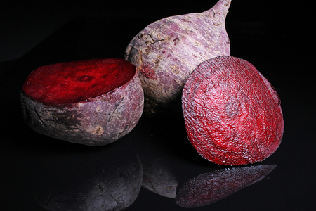 Beetroot beet on black reflective studio background. Isolated black shiny mirror mirrored background for every concept.. Stock Photo